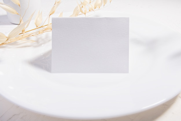 Blank card or note with dry plants flower Premium Photo