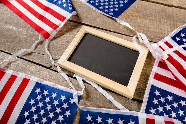 Blank chalk board with american flag Premium Photo