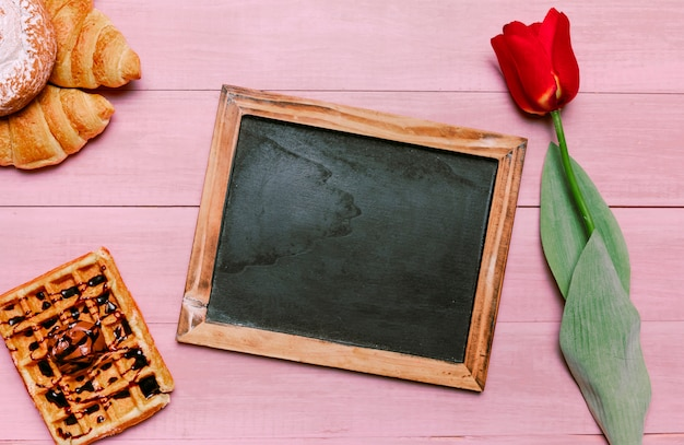 Blank chalkboard with belgian waffle and tulip Free Photo