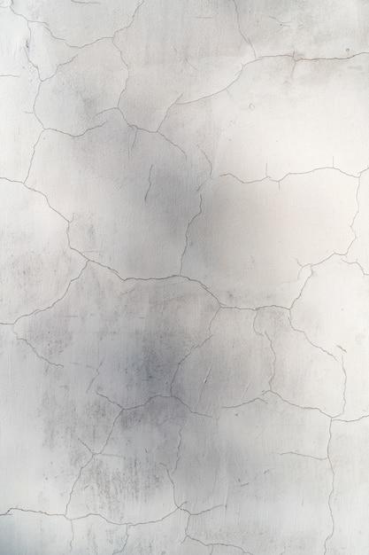 Colore bianco del muro di cemento incrinato in bianco per il fondo di struttura Foto Gratuite