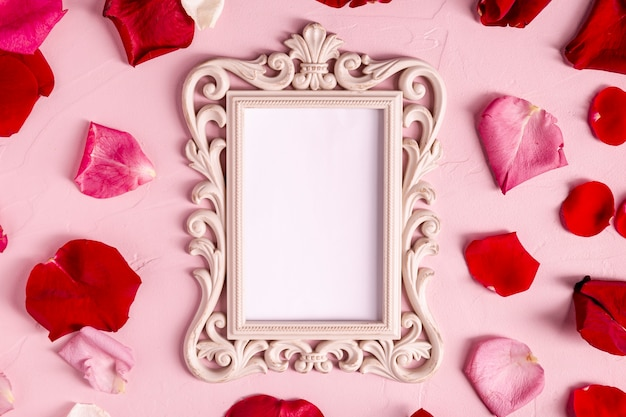 Blank decorative frame with rose petals Free Photo