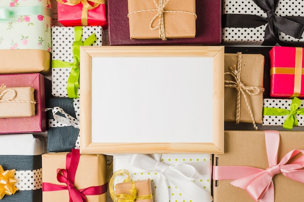 Blank empty frame on various gift box backdrop Free Photo