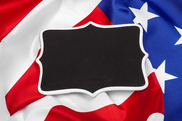 Blank frame on american flag background Premium Photo