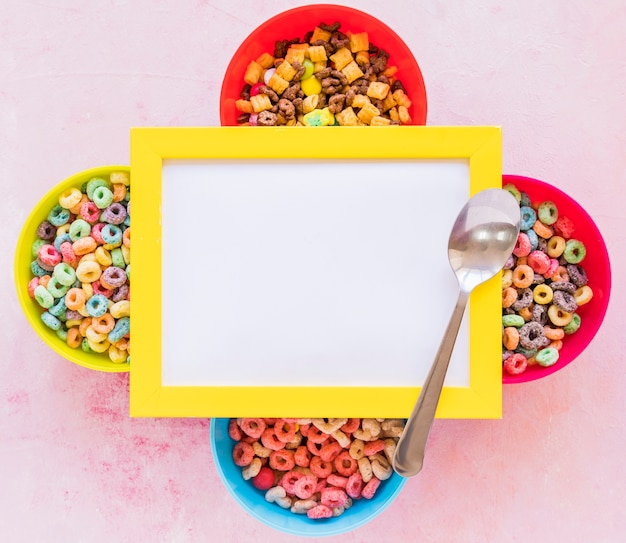 Blank frame on bowls with cereals Free Photo
