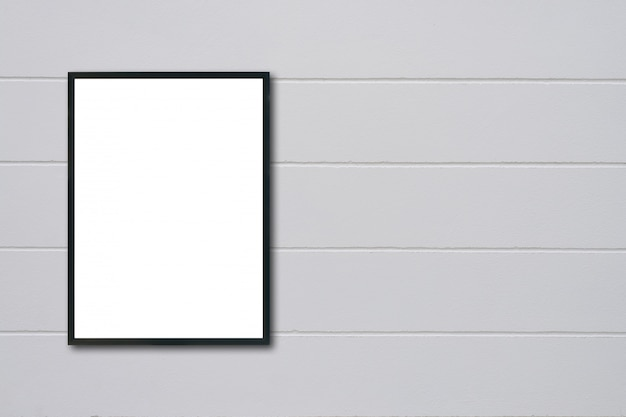 Blank frame hanging on wall. Premium Photo