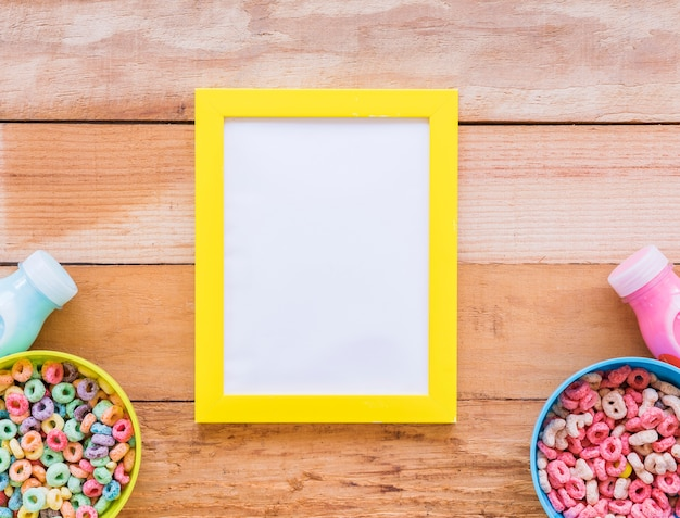 Blank frame with bowls of cereals and milk Free Photo