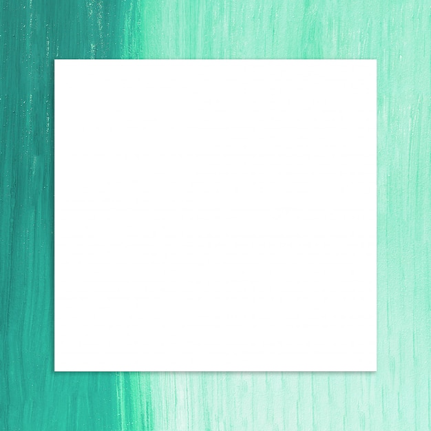 Blank frame with brush of green paint background Free Photo
