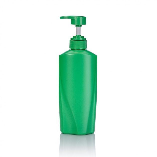 Blank green plastic pump bottle used for shampoo or soap. Premium Photo
