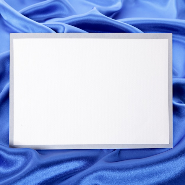 Blank greetings card or invitation with blue satin background. Free Photo