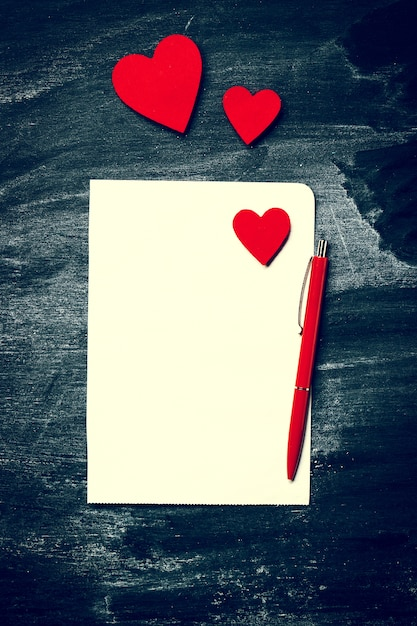 blank letter with red hearts