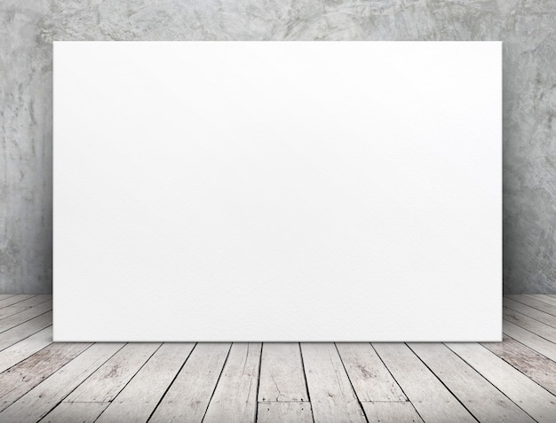 Blank long white paper poster leaning at concrete wall on wooden plank floor in room Premium Photo