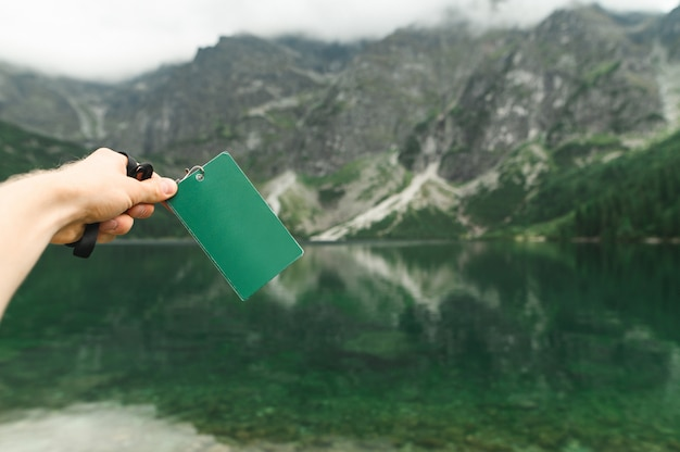 Blank map on the background of lake morskie oko, tatra mountains. Premium Photo