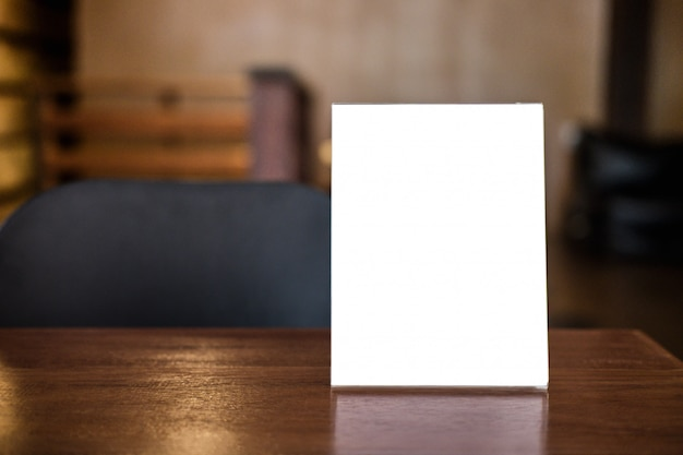 Blank menu frame on table in coffee shop stand for text of display Premium Photo
