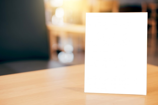 Blank menu frame on table in coffee shop stand for your text of display Premium Photo