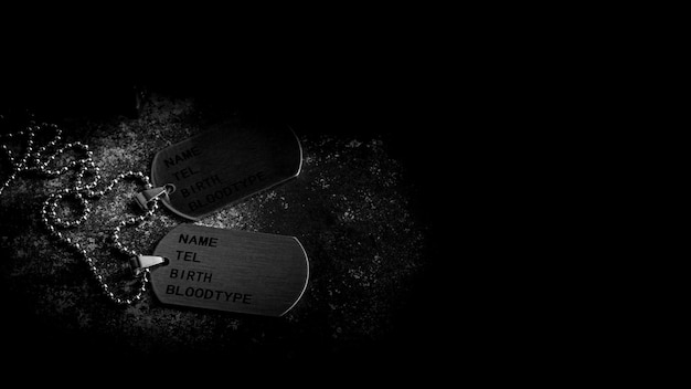 Blank military dog tags on abandoned rusty metal plate. - memories and sacrifices concept. Premium Photo
