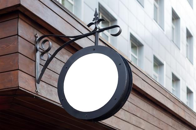 空白の最小限の円形の店の看板 Premium写真