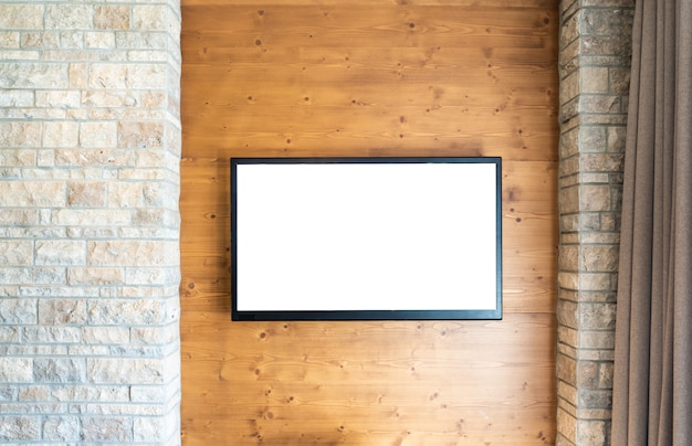 Blank modern flat screen tv at the brick and wooden wall with copy space Premium Photo