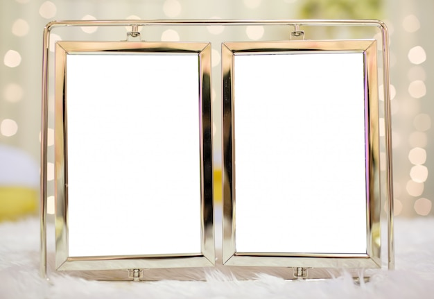 Blank modern picture frame in wedding ceremony with bokeh background Premium Photo