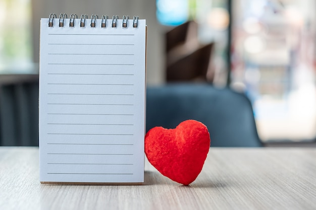 Blank note book with red heart shape Premium Photo