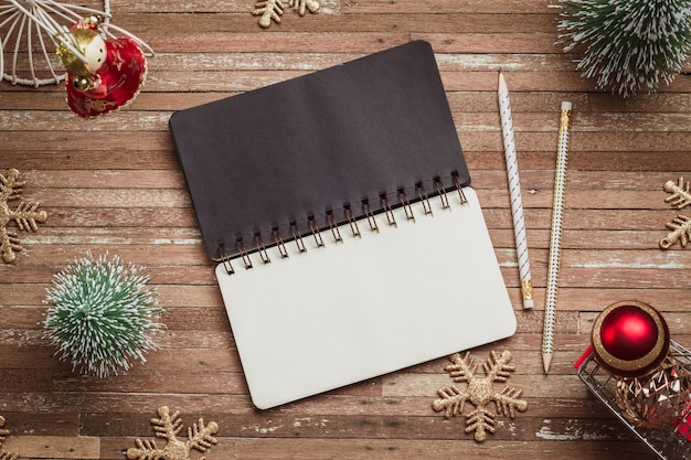 Blank notebook for mockup on wood for christmas background Premium Photo