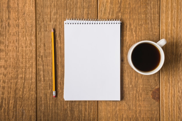 Blank notebook on table Free Photo