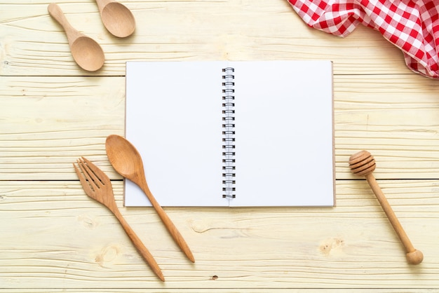 Blank notebook for text note on wooden surface with copy sapce Premium Photo