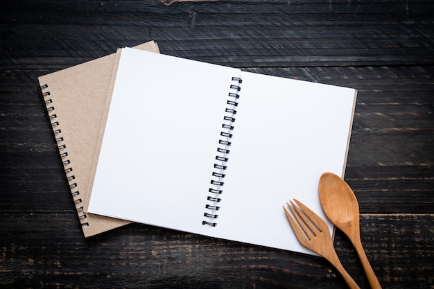 Blank notebook for text note on wooden surface Premium Photo