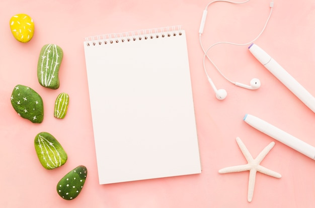 Blank notebook with earphones and sea star Free Photo