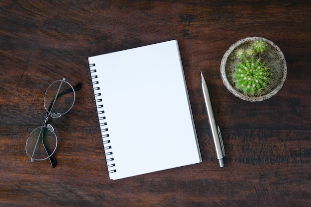 Blank notebook with pen is on top of white desk table. top view, flat lay. Premium Photo
