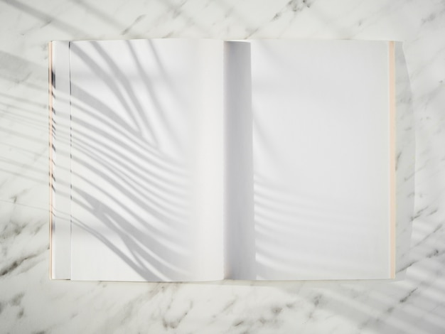 Blank notebook with shadows top view Premium Photo