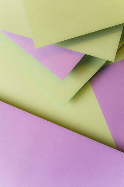 Blank paper cards layered over one another forming background Free Photo