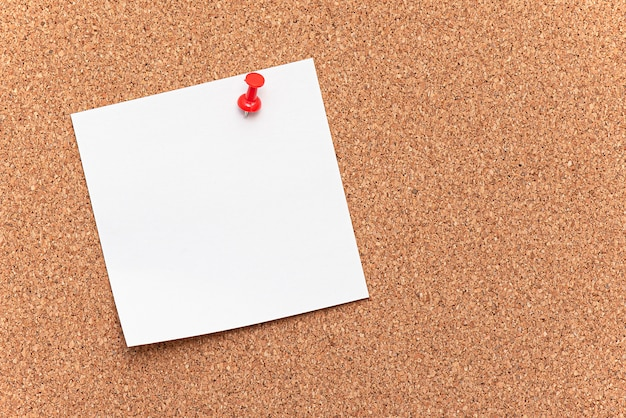 Blank paper, hanging on the board as cork tree with a red pin, concept, office Premium Photo