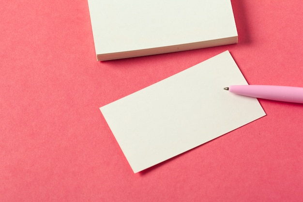 Blank paper pieces  on a colored pink background Premium Photo