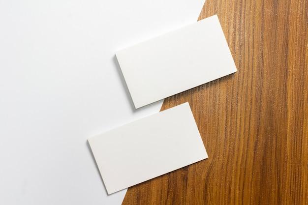 Blank paper stationery set on wooden desk Free Photo