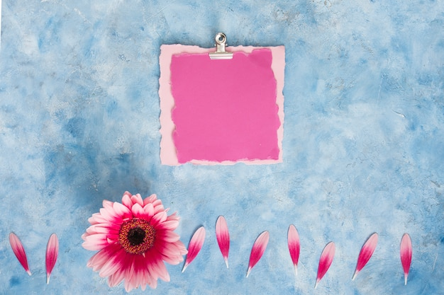 Blank paper with gerbera flower on table Free Photo