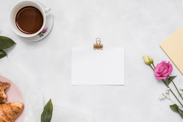 Blank paper with rose and coffee cup Free Photo