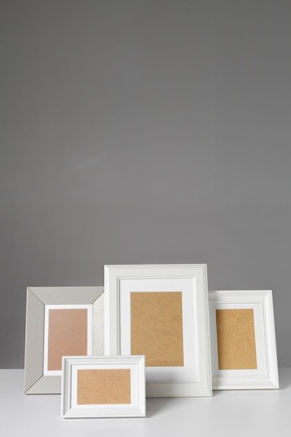 Blank photo frame on the table Premium Photo