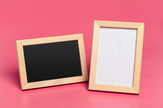Blank photo frames on pink colored background Premium Photo