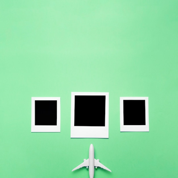 Blank photos with small airplane Free Photo