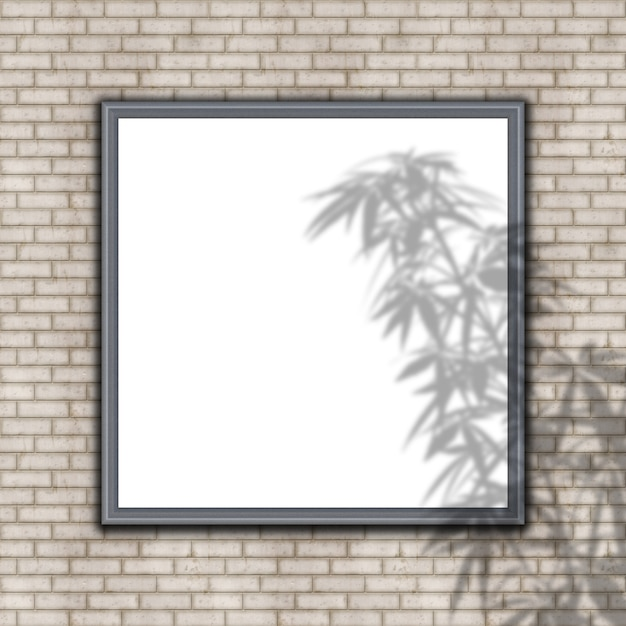 Blank picture frame on brick wall with plant shadow overlay Free Photo