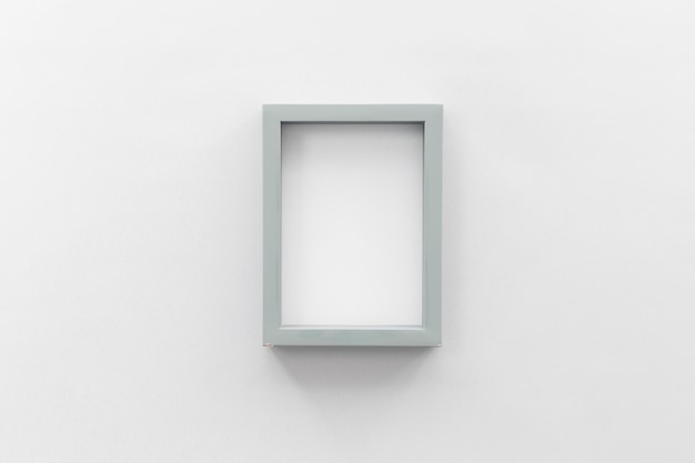 Blank picture frame on white wall Free Photo