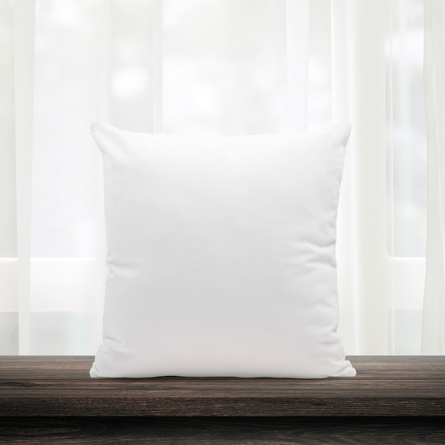 Blank pillows made from soft feather on morning window and curtains Premium Photo