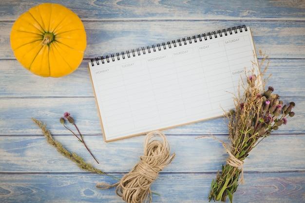 Blank planner with autumn pumpkins Premium Photo