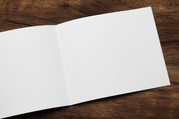 Blank portrait mock-up paper. brochure magazine isolated on brown wooden table Premium Photo