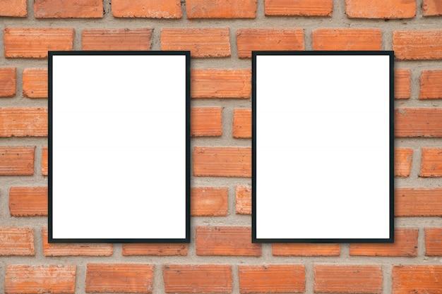 レンガの壁に空白のポスター額縁。 Premium写真