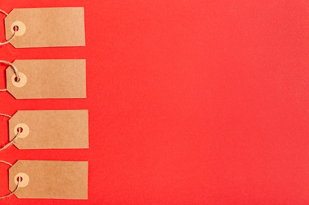 Blank price tags on red background with copy space Premium Photo
