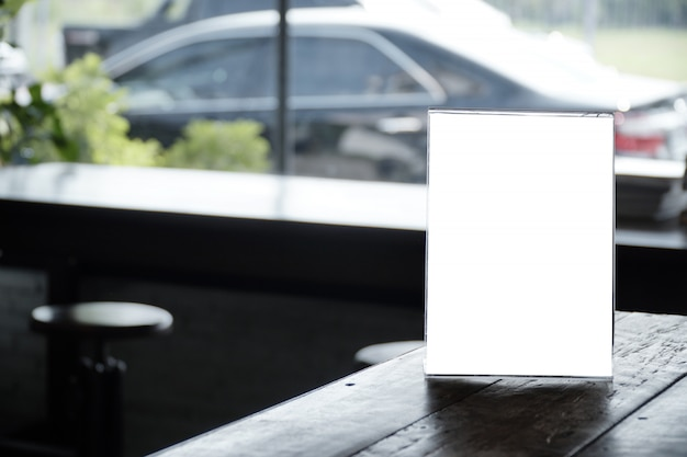 Blank promotion poster display on glass window at restaurant or cafe Premium Photo