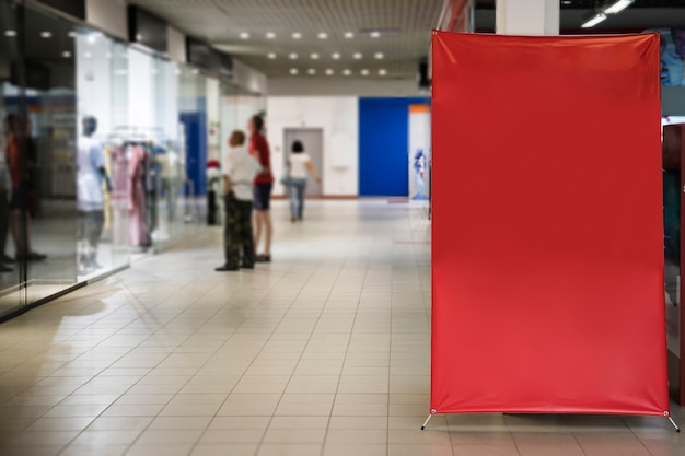 Blank red sign inside shopping mall Free Photo