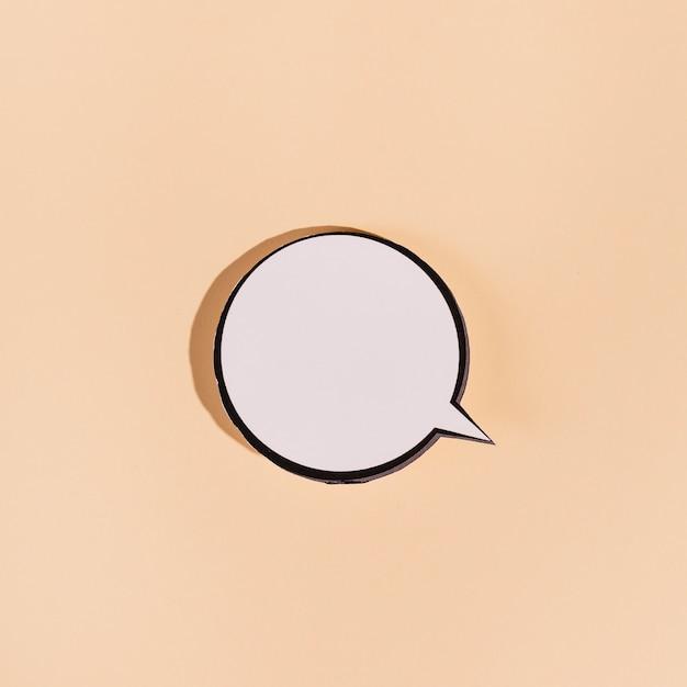 Blank round speech bubble on beige background Free Photo