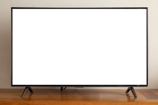 Blank screen led television on wood table. Premium Photo